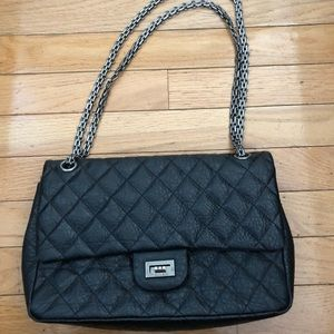 Black leather quilted bag with chain handle